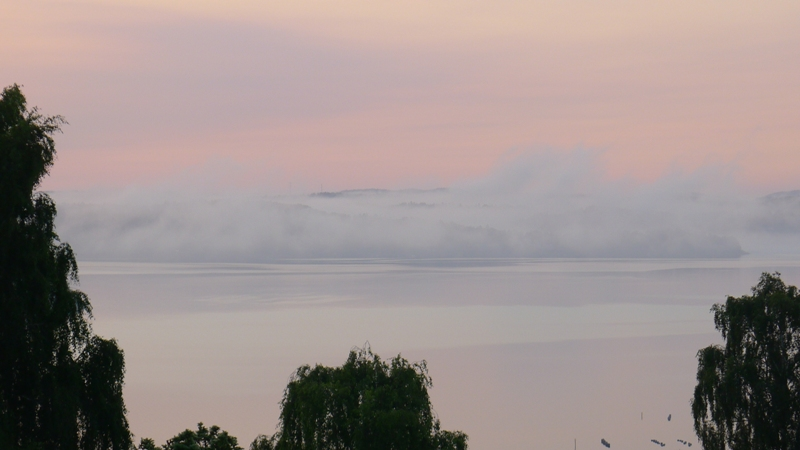 Clouds drifting off the coast at dawn